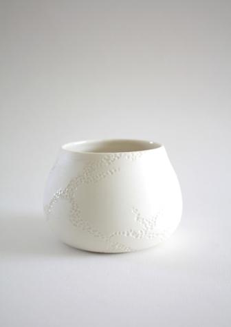 tasse.porcelaine.motif_.creuse.matiere.6